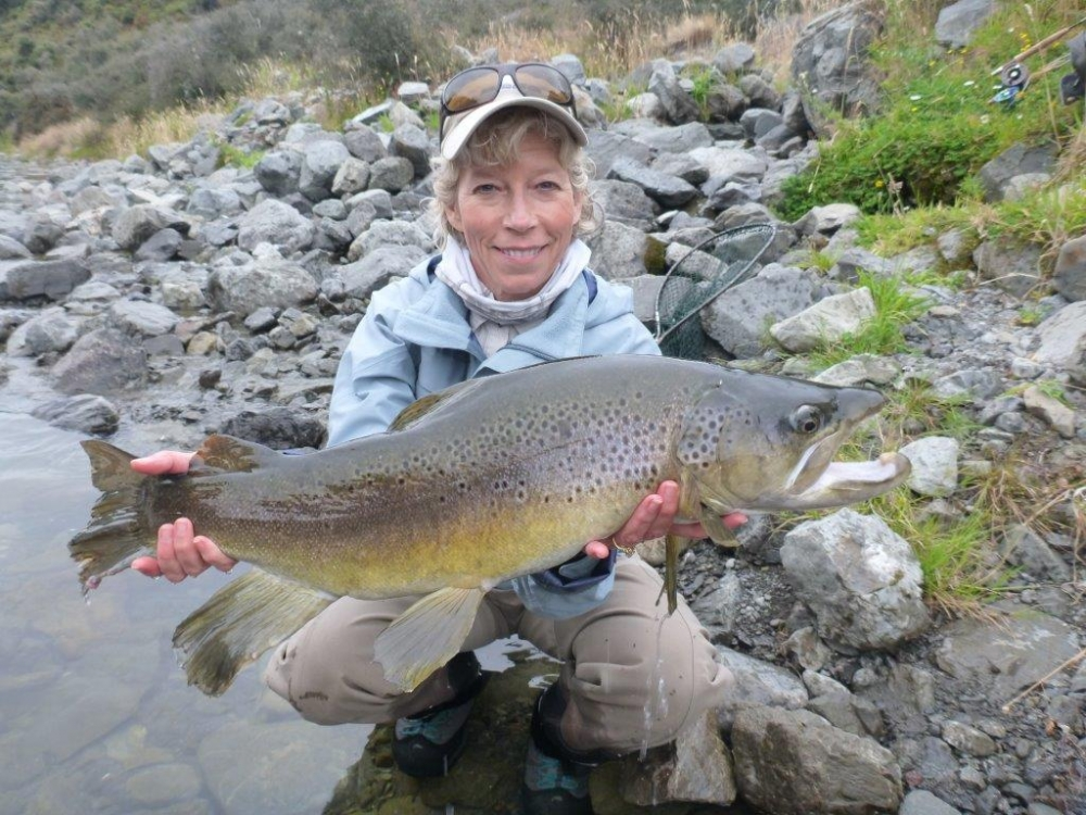 Carla Ribic's also happy with her 10.5  pound brown trout. .