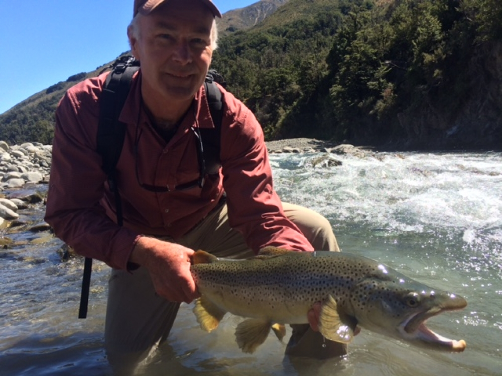 Dr Don Cubberley is very happy with his brown trout catch.