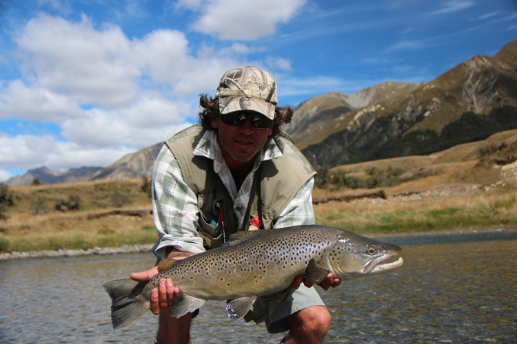 Guided fly fishing trips packages new zealand for New zealand trout fishing